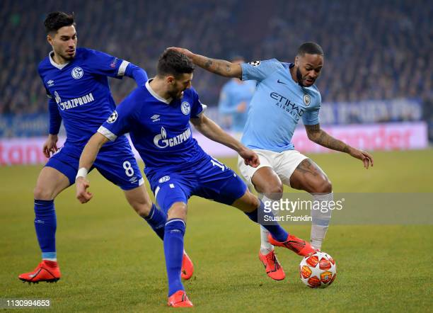 Daniel Caligiuri of Schalke challenges Raheem Sterling of Manchester City during the UEFA Champions League Round of 16 First Leg match between FC...