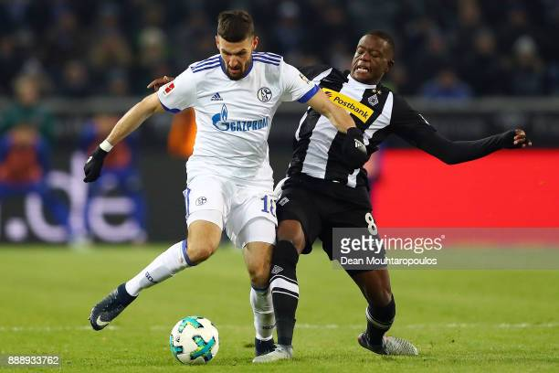 Daniel Caligiuri of Schalke fights for the ball with Denis Zakaria of Moenchengladbach during the Bundesliga match between Borussia Moenchengladbach...