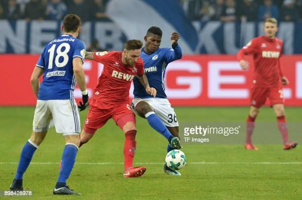 Daniel Caligiuri of Schalke Marco Hoeger of Koeln and Breel Embolo of Schalke battle for the ball during the Bundesliga match between FC Schalke 04...