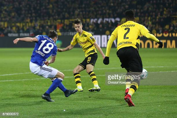 Daniel Caligiuri of Schalke scores a goal to make it 34 during the Bundesliga match between Borussia Dortmund and FC Schalke 04 at Signal Iduna Park...