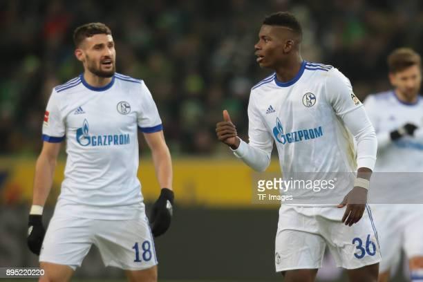 Daniel Caligiuri of Schalke speaks with Breel Embolo during the Bundesliga match between Borussia Moenchengladbach and FC Schalke 04 at BorussiaPark...