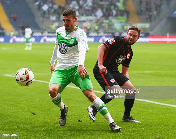 Daniel Caligiuri of VfL Wolfsburg evades Marc Stendera of Eintracht Frankfurt during the Bundesliga match between Eintracht Frankfurt and VfL...