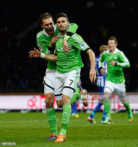 Daniel Caligiuri of Wolfsburg celebrates after he scores his team' second goal with team mate Bas Dost during the Bundesliga match between Hertha BSC...