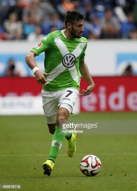 Daniel Caligiuri of Wolfsburg runs with the ball during the Bundesliga match between 1899 Hoffenheim and VfL Wolfsburg at Wirsol RheinNeckarArena on...