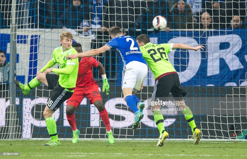 Daniel Caliguri of Schalke (M) scores his teams third goal during the UEFA Europa League quarter final second leg match between FC Schalke 04 and Ajax Amsterdam at Veltins-Arena on April 20, 2017 in Gelsenkirchen, Germany.