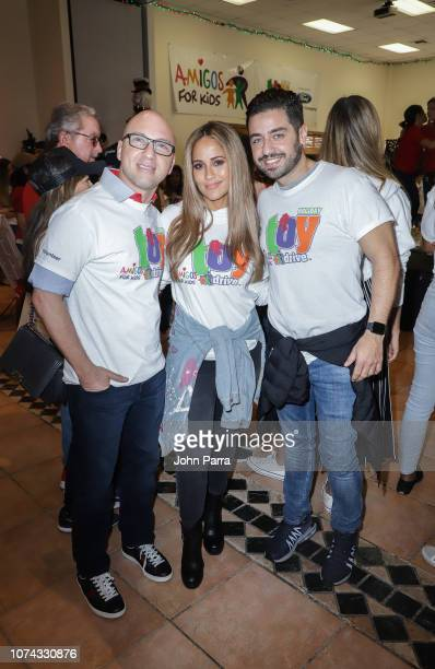 Daniel Campos Borja Voces and Jackie Guerrido attend the Amigos For Kids 27th Annual Holiday Toy Drive on December 16 2018 in Miami Florida