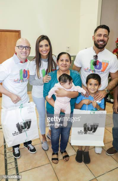 Daniel Campos Erika Csiszer and Federico Diaz attend the Amigos For Kids 27th Annual Holiday Toy Drive on December 16 2018 in Miami Florida