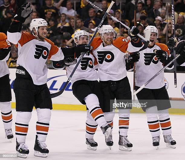Daniel Carcillo Danny Briere Claude Giroux and Matt Carle of the Philadelphia Flyers celebrate the win over the Boston Bruins in Game Seven of the...