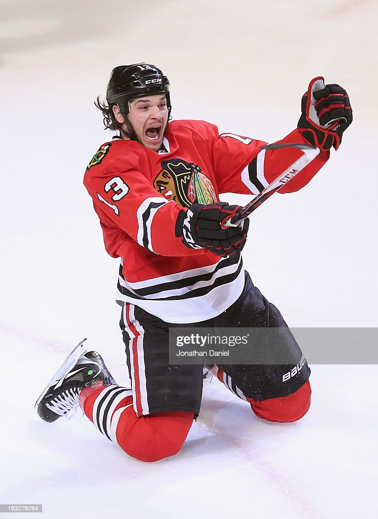 Daniel Carcillo #13 of the Chicago Blackhawks celebrates his game-winning goal against the Colorado Avalanche at the United Center on March 6, 2013 in Chicago, Illinois. The Blackhawks defeated the Avalanche 3-2.