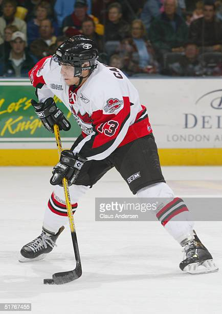 Daniel Carcillo of the Mississauga IceDogs looks to put a shot on net against the London Knights during the Ontario Hockey League game at John Labatt...