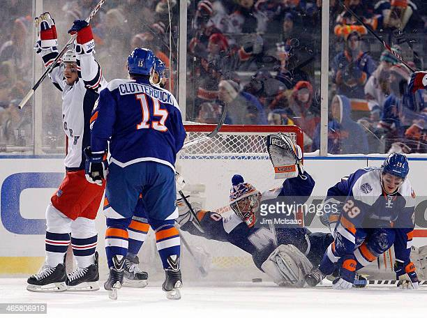 Daniel Carcillo of the New York Rangers celebrates his game winning goal as the puck goes past Cal Clutterbuck and Evgeni Nabokov of the New York...