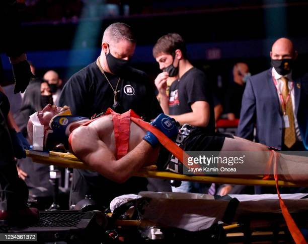 Daniel Carey is taken off with a C-collar and backboard after he was knocked out by Gadzhi Rabadanov who won by TKO in the second round of their 150...