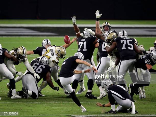 Daniel Carlson of the Las Vegas Raiders kicks a field goal at the end of the fourth quarter against the New Orleans Saints at Allegiant Stadium on...
