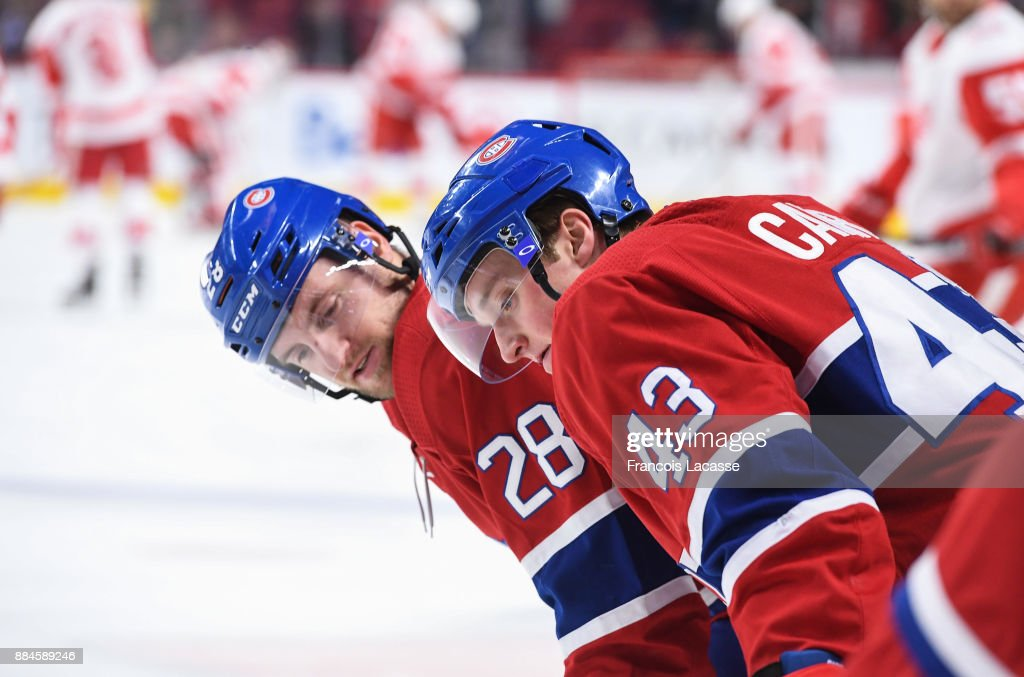Daniel Carr #43 and Jakub Jerabek #28 of the Montreal Canadiens exchange words during warm up prior to the game against the Detroit Red Wings in the NHL game at the Bell Centre on December 2, 2017 in Montreal, Quebec, Canada.
