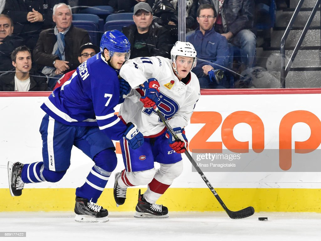 Daniel Carr #11 of the Laval Rocket skates the puck against Timothy Liljegren #7 of the Toronto Marlies during the AHL game at Place Bell on November 1, 2017 in Laval, Quebec, Canada. The Toronto Marlies defeated the Laval Rocket 3-0.
