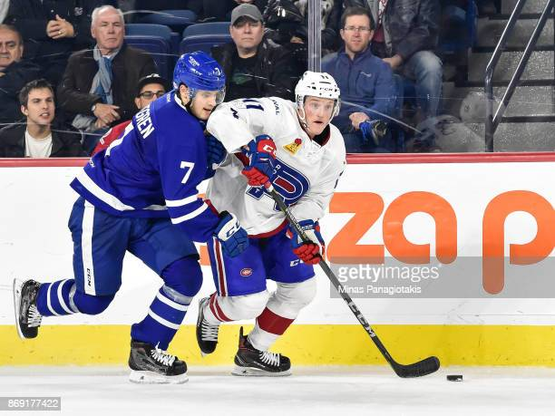 Daniel Carr of the Laval Rocket skates the puck against Timothy Liljegren of the Toronto Marlies during the AHL game at Place Bell on November 1 2017...
