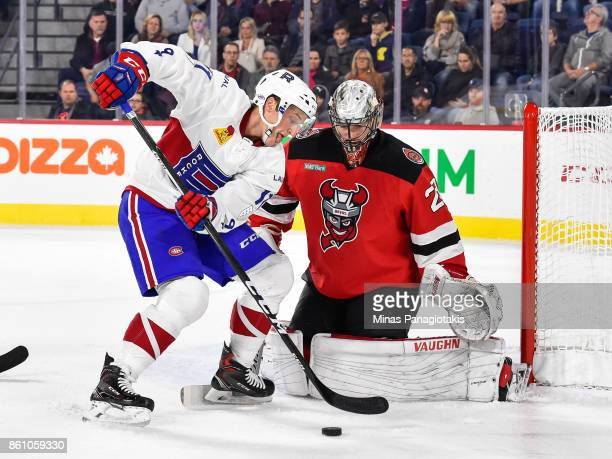 Daniel Carr of the Laval Rocket tries to get a shot on goaltender Mackenzie Blackwood of the Binghamton Devils during the AHL game at Place Bell on...