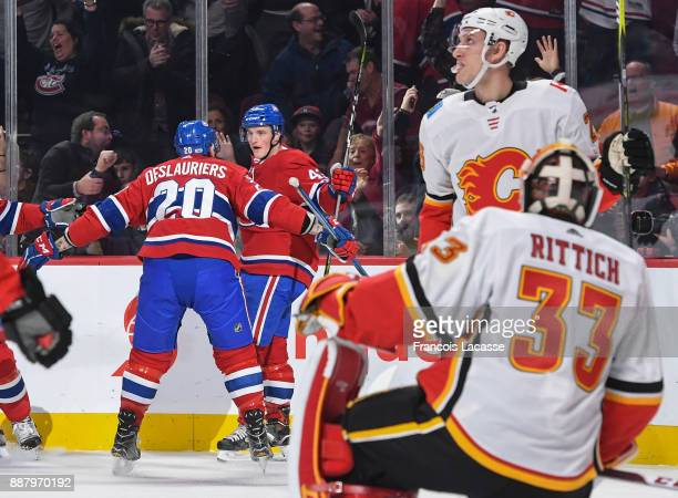 Daniel Carr of the Montreal Canadiens celebrate after scoring a goal against the Calgary Flames in the NHL game at the Bell Centre on December 7 2017...