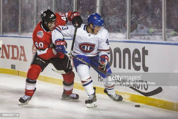 Daniel Carr of the Montreal Canadiens controls the puck against Gabriel Dumont of the Ottawa Senators at the 2017 Scotiabank NHL 100 Classic at...
