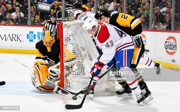 Daniel Carr of the Montreal Canadiens handles the puck against Casey DeSmith of the Pittsburgh Penguins at PPG Paints Arena on March 21 2018 in...
