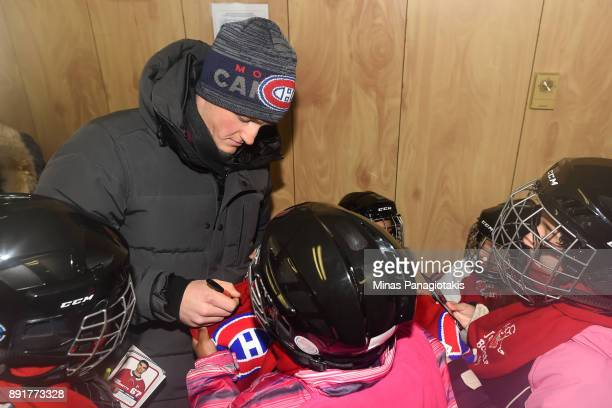 Daniel Carr of the Montreal Canadiens meets and signs autographs for children during the official inauguration of the Bleu Blanc Bouge rink by the...