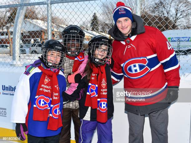Daniel Carr of the Montreal Canadiens poses with a few children during the official inauguration of the Bleu Blanc Bouge rink by the Montreal...