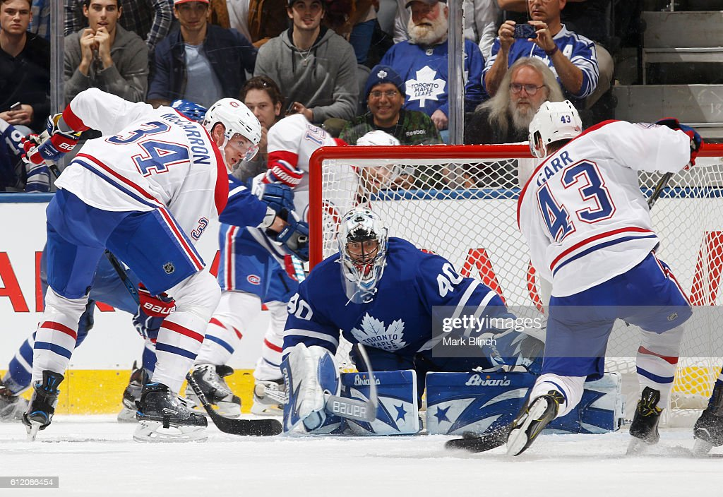 Daniel Carr #43 of the Montreal Canadiens scores on Garret Sparks #40 of the Toronto Maple Leafs as Michael McCarron #34 of the Montreal Canadiens looks on during the third period of their NHL preseason game at the Air Canada Centre on October 2, 2016 in Toronto, ON, Canada.