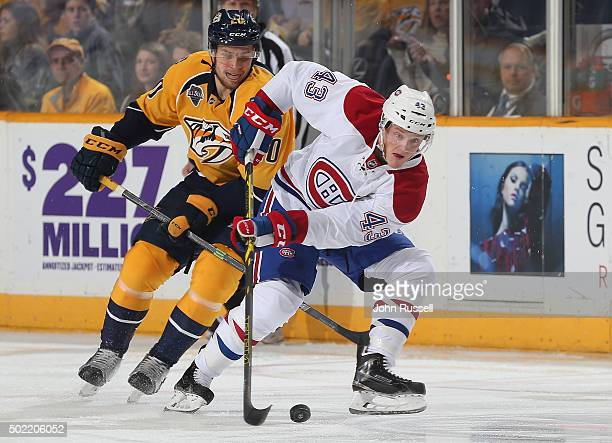 Daniel Carr of the Montreal Canadiens skates against Miikka Salomaki of the Nashville Predators during an NHL game at Bridgestone Arena on December...
