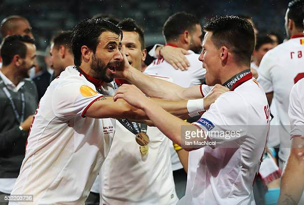 Daniel Carrico and Grzegorz Krychowiak of Sevilla celebrate during the UEFA Europa League Final match between Liverpool and Sevilla at St JakobPark...
