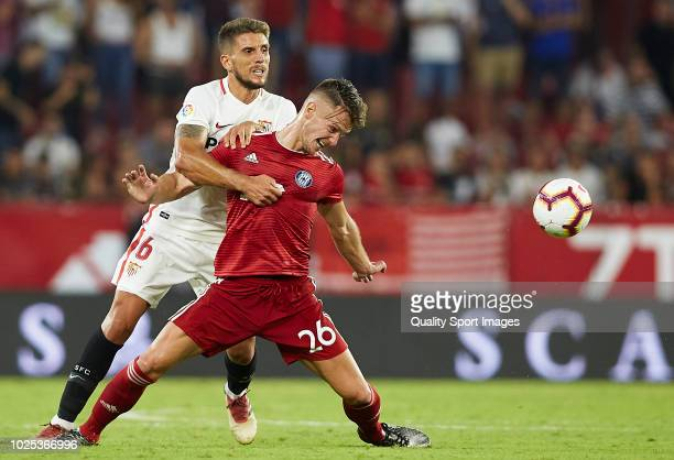Daniel Carrico of Sevilla competes for the ball with Martin Nespor of Sigma Olomuc during the UEFA Europa League Qualifying PlayOff Second Leg match...