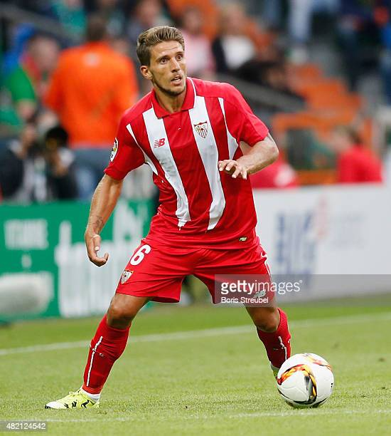 Daniel Carrico of Sevilla runs with the ball during the friendly match between SV Werder Bremen and FC Sevilla at Weserstadion on July 25 2015 in...