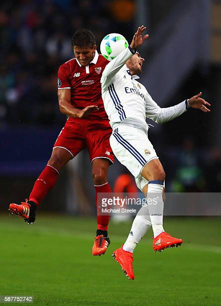 Daniel Carrico of Sevilla wins a header with Alvaro Morata of Real Madrid during the UEFA Super Cup match between Real Madrid and Sevilla at...