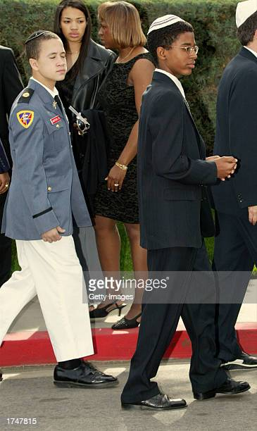 Daniel Carter and his brother Joshua Carter sons of actress Nell Carter attend their mother's funeral at Hillside Memorial Park on January 27 2003 in...