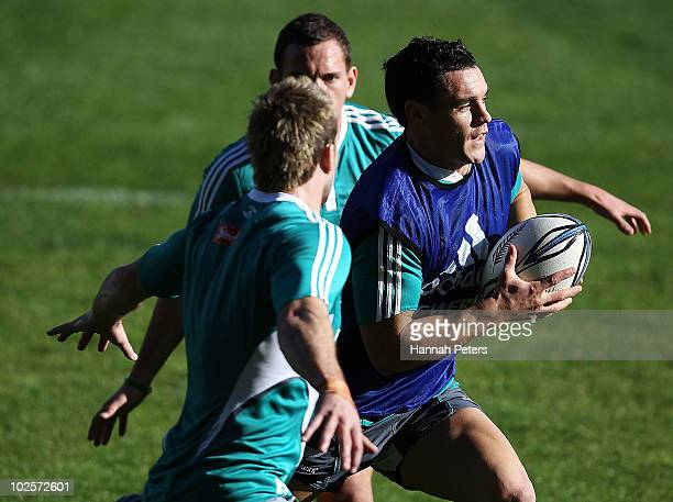 Daniel Carter makes a break during a New Zealand All Blacks training session at North Harbour Stadium on July 2 2010 in Auckland New Zealand