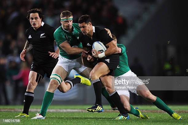 Daniel Carter of the All Blacks makes a break during the International Test Match between the New Zealand All Blacks and Ireland at Eden Park on June...