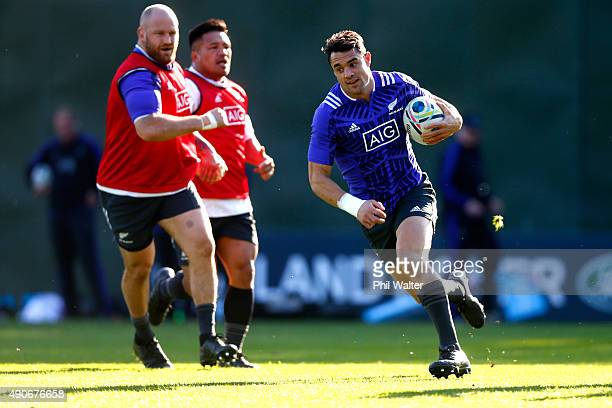 Daniel Carter of the All Blacks runs the ball during a New Zealand All Blacks Training Session at Sophia Gardens on September 30, 2015 in Cardiff,...