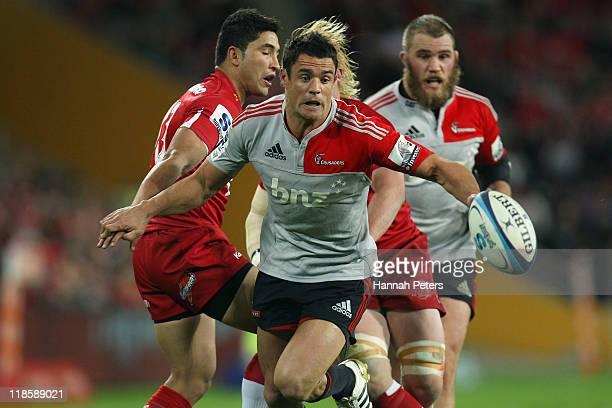 Daniel Carter of the Crusaders kicks the ball through to score during the 2011 Super Rugby Grand Final match between the Reds and the Crusaders at...