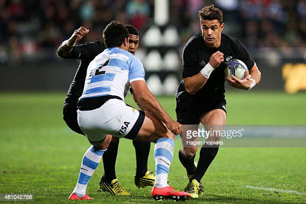 Daniel Carter of the New Zealand All Blacks runs at Jeronimo De la Fuente of Argentina during The Rugby Championship match between the New Zealand...