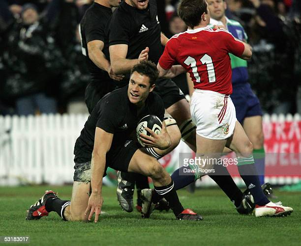 Daniel Carter the All Black standoff celebrates after scoring his second try during the second test match between The New Zealand All Blacks and the...