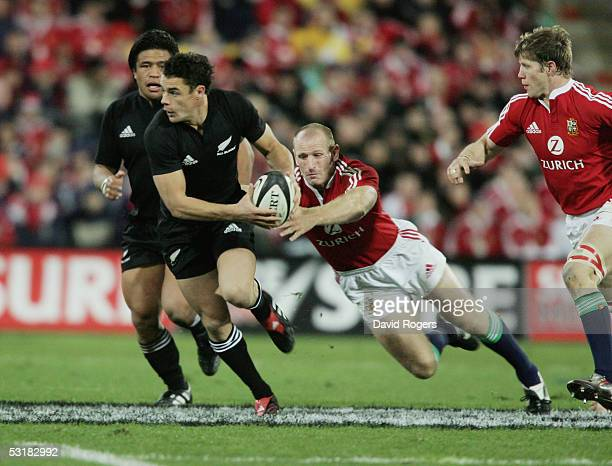 Daniel Carter the All Black standoff moves away from Gareth Thomas during the second test match between The New Zealand All Blacks and the British...