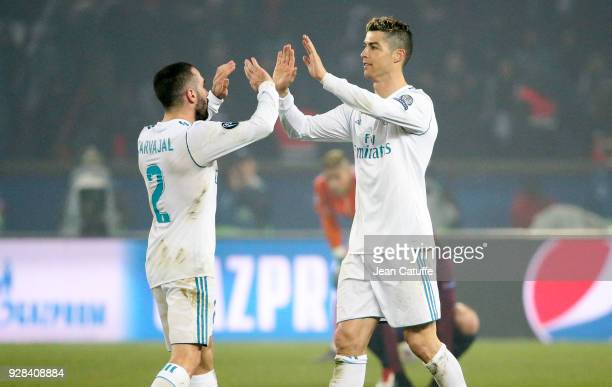 Daniel Carvajal and Cristiano Ronaldo of Real Madrid celebrate the victory following the UEFA Champions League Round of 16 Second Leg match between...