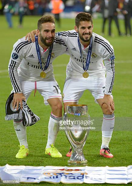 Daniel Carvajal and Isco of Real Madrid celebrate with the trophy after the UEFA Super Cup match between Real Madrid and Sevilla FC at Cardiff City...