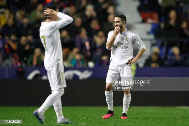 Daniel Carvajal and Lucas Vazquez of Real Madrid gestures after the goal of Levante UD during the Liga match between Levante UD and Real Madrid CF at...