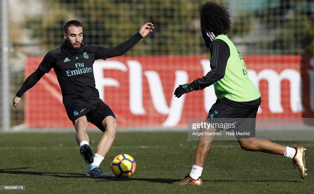 Daniel Carvajal (L) and Marcelo of Real Madrid in action during a training session at Valdebebas training ground on December 1, 2017 in Madrid, Spain.