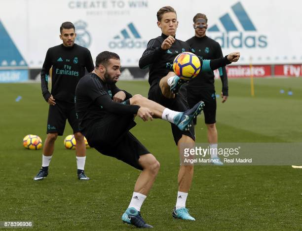 Daniel Carvajal and Marcos Llorente of Real Madrid in action during a training session at Valdebebas training ground on November 24 2017 in Madrid...