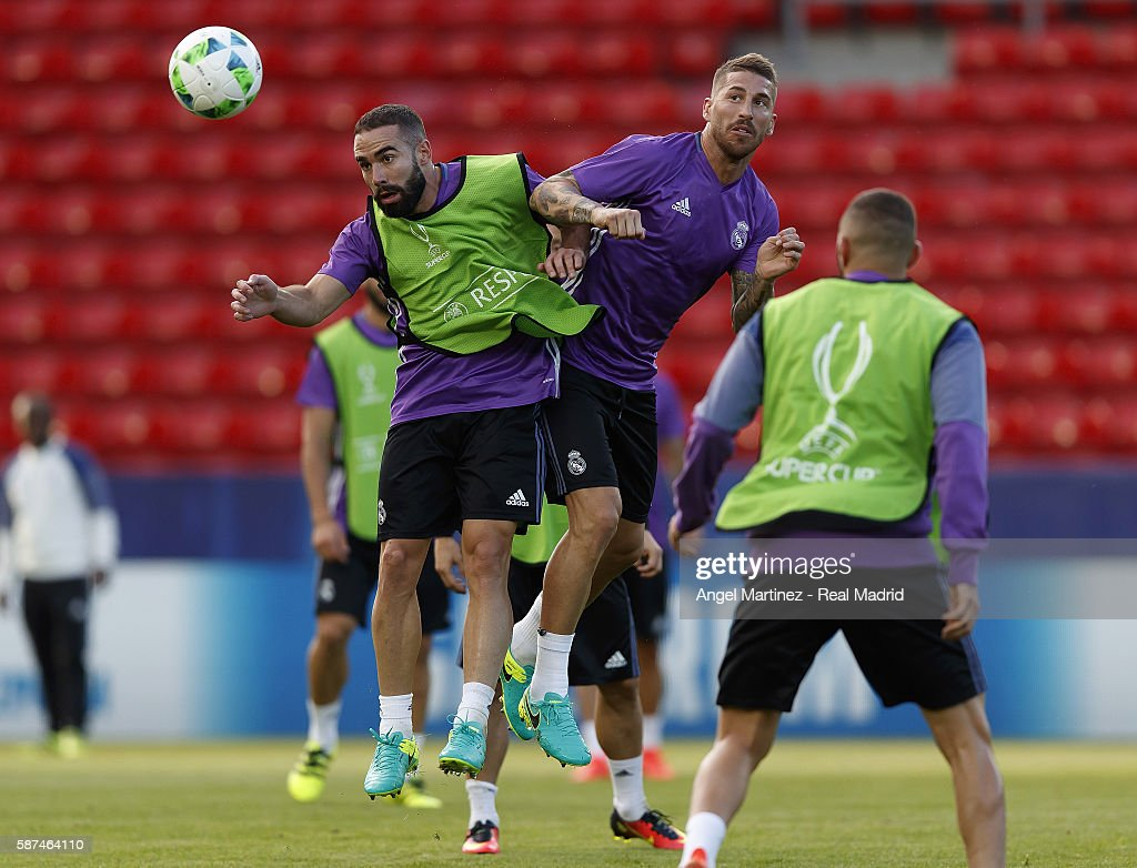 Daniel Carvajal (L) and Sergio Ramos of Real Madrid in action during a training session at Lerkendal Stadion on August 8, 2016 in Trondheim, Norway.