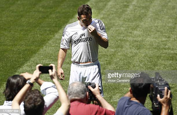 Daniel Carvajal kisses the Real madrid Badge during his official presentation as new Real Madrid player at the Santiago Bernabeu stadium on July 5...
