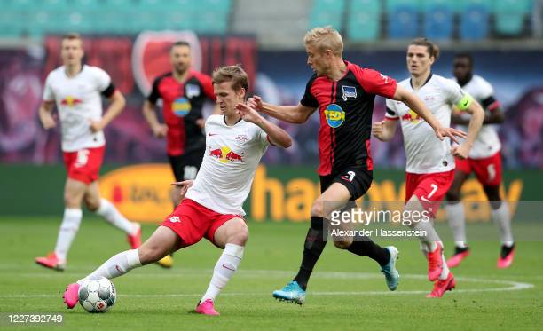 Daniel Carvajal of Leipzig challenges Per Skjelbred of Hertha Berlin during the Bundesliga match between RB Leipzig and Hertha BSC at Red Bull Arena...