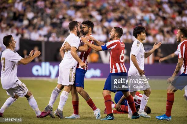 Daniel Carvajal of Real Madrid and Diego Costa of Atletico Madrid stand nose to nose trying to resolve a conflict during the International Champions...