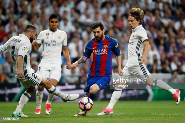 Daniel Carvajal of Real Madrid and Lionel Messi of FC Barcelona battle for the ball Kuka Modric of Real Madrid during the La Liga match between Real...